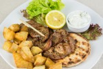 Gyros flavoured pork with pita bread, French fries and tzatziki