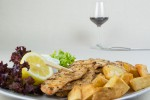 Chicken souvlaki with salad, French fries and yogurt dip