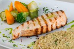 Grilled salmon with steamed vegetables and creole rice