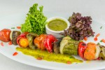 Vegetable souvlaki with grilled colored bell peppers, mushrooms, Santorini's cherry tomatoes, zucchinis, carrots and onions